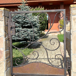 A hand wrought-iron small gate forged in UKOVMI for a family house