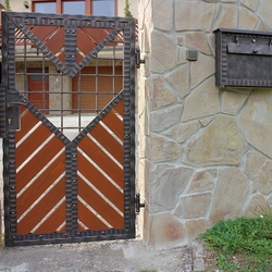 A modern gate - wood - metal, harmony of materials - A wrought iron gate