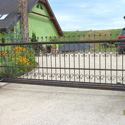 A wrought iron gate -  A sliding gate