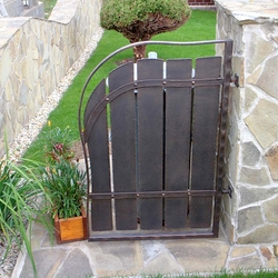 A wrought iron gate for a rubbish bin