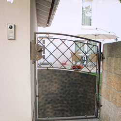 A forged gate with sheet metal