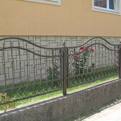 A wrought iron gate - various patterns - A modern fence