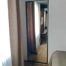 Metal square mirrors in hotel rooms – modern mirrors