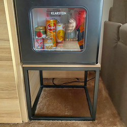 The simple metal table under the fridge – modern hotel furniture